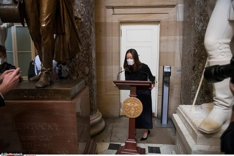 An aide wheels Pelosi's lectern through Statuary Hall at the U.S. Capitol on Wednesday. The lectern was found on January 7 by a member of the Senate staff in the Red corridor of the Senate wing off the Rotunda in the Capitol building