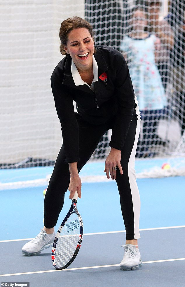 Kate Middleton plays tennis during a visit to the Lawn Tennis Association at the National Tennis Centre in London, England on October 31, 2017