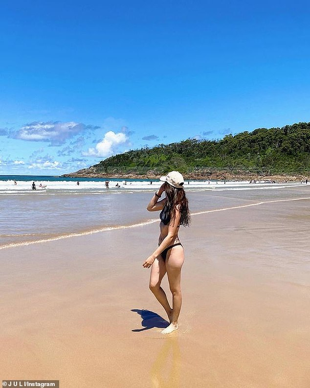 A holidaymaker is seen on a beach in Port Stephens. The council has advised visitors to swim at other nearby shores, including the patrolled beaches at Fingal Beach, One Mile Beach and Birubi Beach