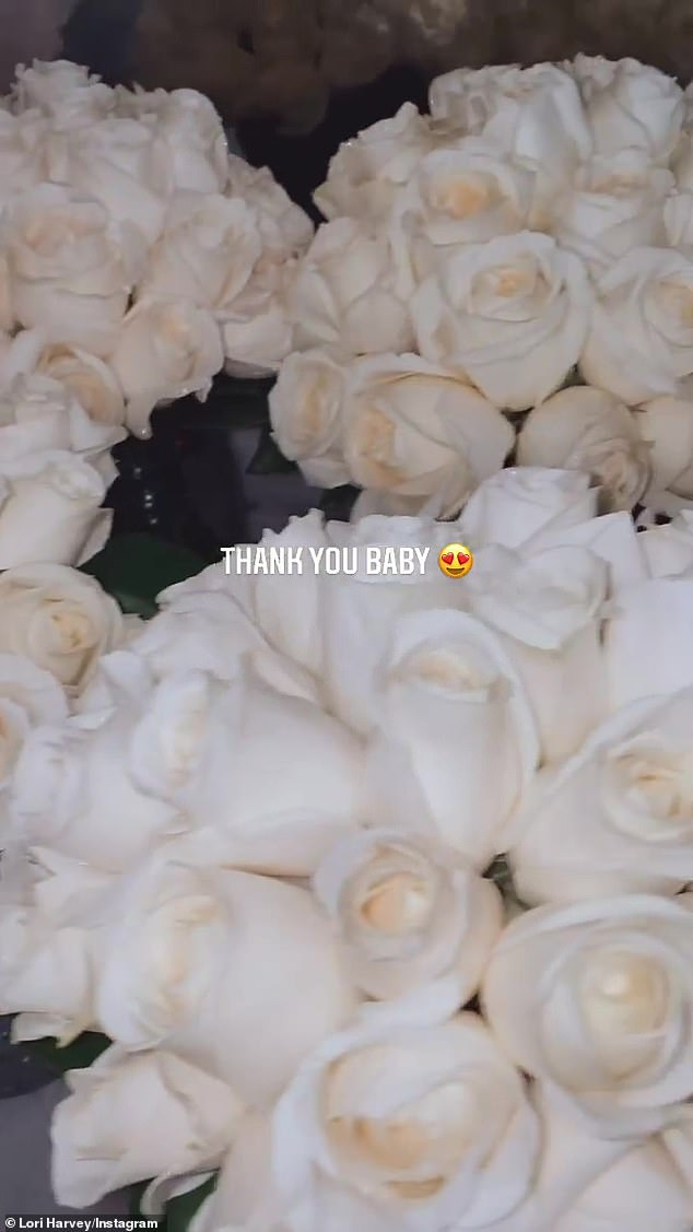 'Thanks baby!'  Jordan bought Harvey 15 bouquets of white roses for her special day, which they celebrated with a party at her Atlanta home with friends and family.