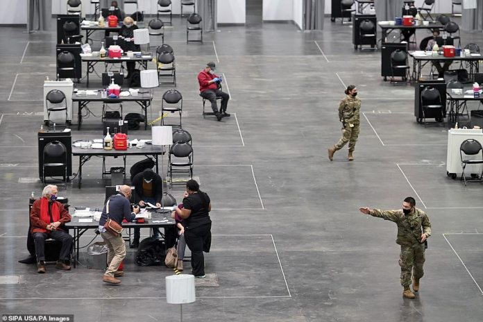 Big states such as California and New York are trying to accelerate their roll-outs by opening giant vaccination centers. Pictured: The Javits Center in NYC, which has been transformed into a large-scale vaccination site