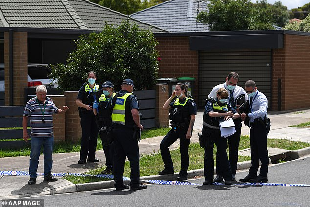 Officers who were called to the scene in Tullamarine stand with police tape on Thursday