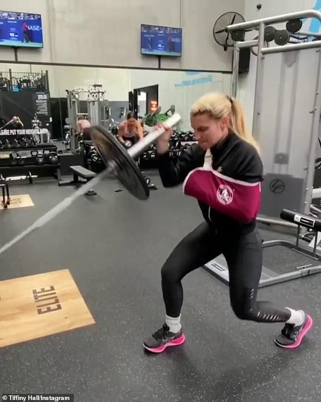 Incredible! Fitness guru Tiffiny Hall (pictured), 36, completed a gruelling workout with just ONE ARM on Thursday, as she recovers from a wrist injury