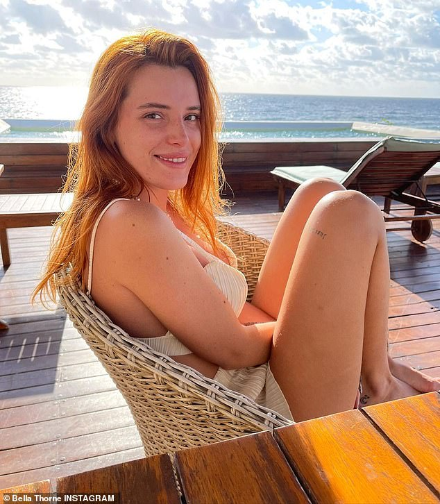 Cute: The 23-year-old Famous In Love actress donned a tiny cream ruched bikini top that revealed her ample cleavage as she relaxed aboard a yacht