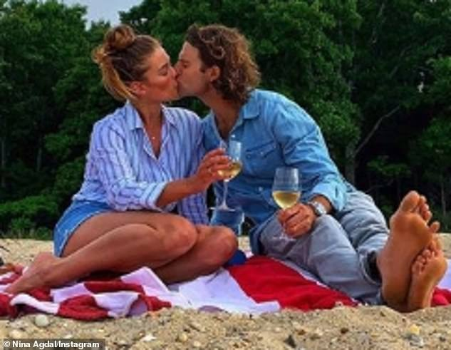 So sweet: Last summer, Nina rang her third birthday with Jack Brinkley-Cook by releasing a sweet album that showed them cuddling and kissing at a picnic on the beach