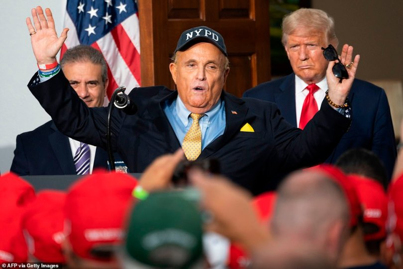 Amid the strain of his final days in office, Trump's relationship with Giuliani may be fracturing. They are seen above at an event in August