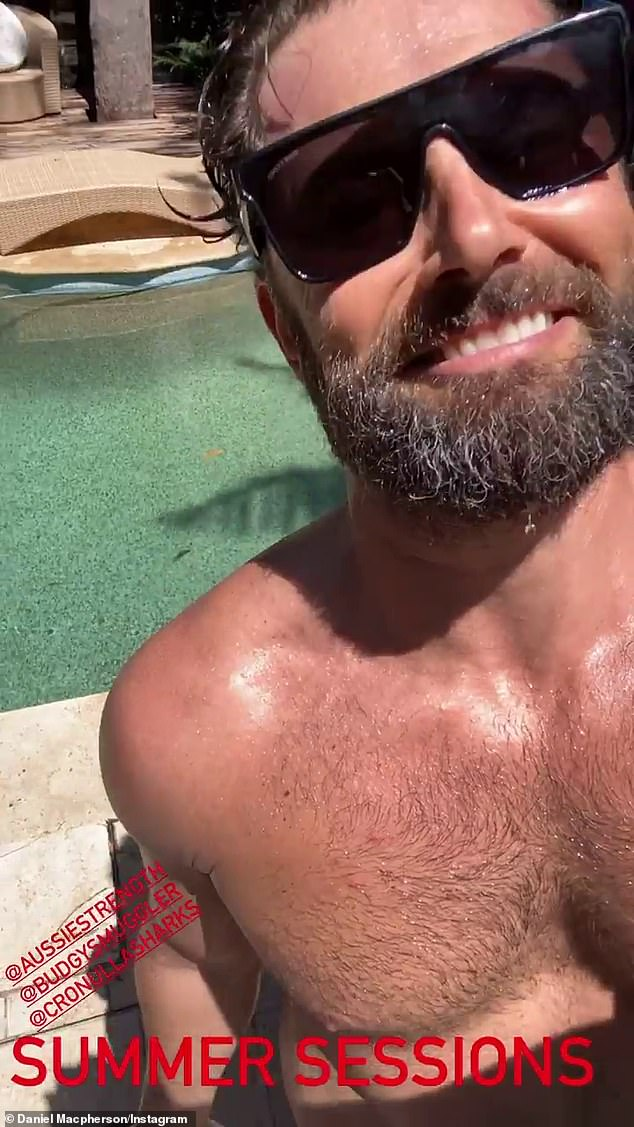 Work a sweat!  Daniel MacPherson kicks off the new year on a more positive start, as he overcame his heartache to focus on his fitness with a sweaty workout by the pool - while wearing nothing but parakeet smugglers blue.