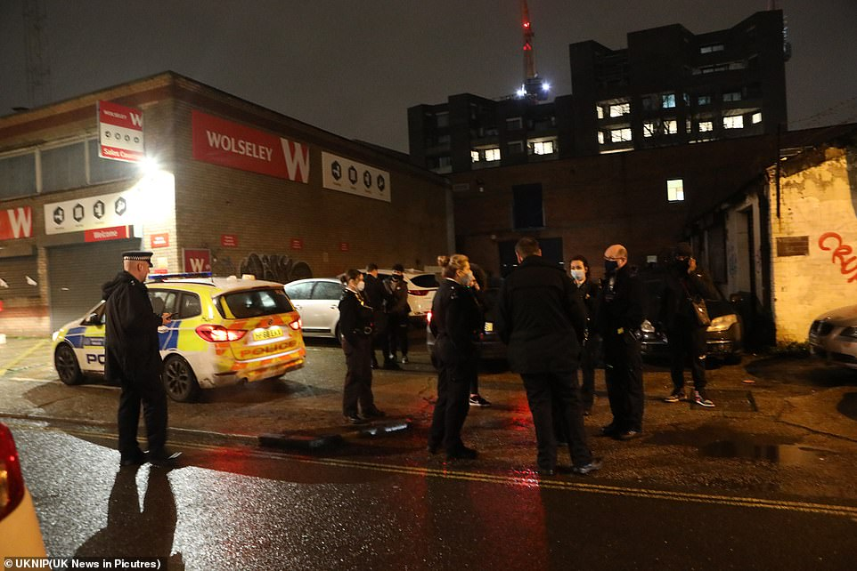 Officers found more than 20 people drinking, eating and playing music, leaving one officer 'astounded' at the rule-breaking
