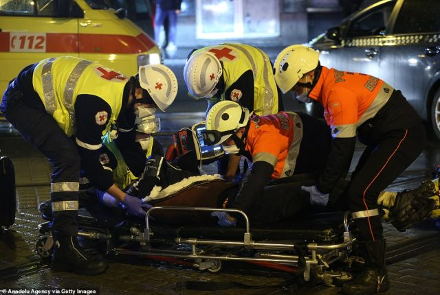 Health care workers administer first aid following the clash between police and demonstrators