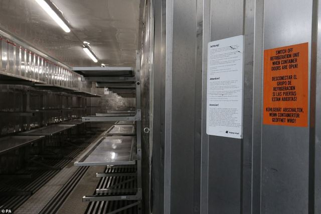 Signs on the walls of a storage unit at the overflow mortuary at Breakspear Crematorium in West London, pictured today