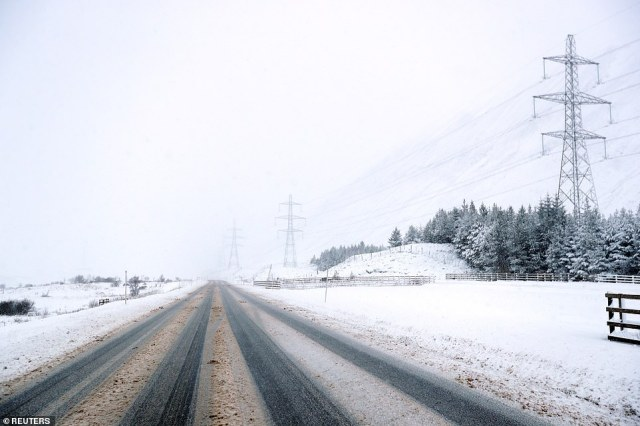 The snowy A9 road at the Pass of Drumochter in Scotland is pictured today following blizzard conditions in the area
