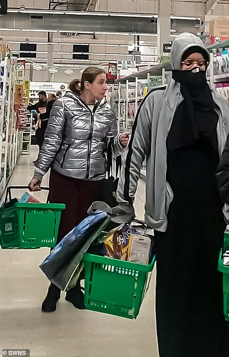 Shoppers at Asda in Cape Hill, Smethwick, yesterday. People do not need to wear masks if they are covered by an exemption in the rules