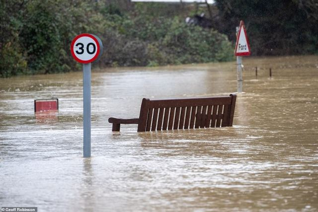 Flooding in the Cambridgeshire village of Alconbury today after the River Great Ouse burst its banks