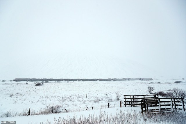 The LNER Inverness train makes its way through the Pass of Drumochter in Scotland today