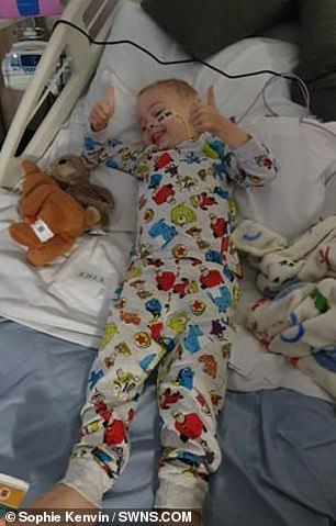 Jaxson is pictured receiving treatment in hospital
