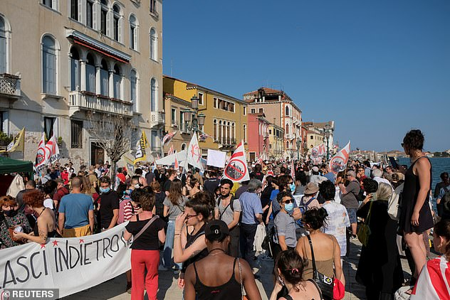 Protesters gathered along Venice's picturesque waterfront in July last year to demonstrate against mass tourism in Italy's floating city