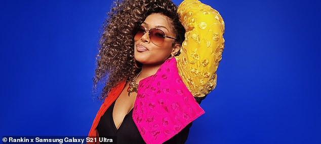 Strike a pose: While a final ensemble saw the rapper in a funky pink, yellow and red patterned embroidered jacket