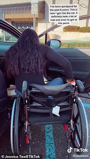 Lots of work: She uses a plank of wood as a bridge from her chair to the seat in the car, hoisting her body onto the wood and shifting it down, bit by bit, into the seat
