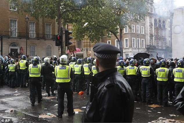 Clips from the day showed the demonstrations turning violent as protestors through items including Boris bikes at the mounted officers. Pictured: Police face demonstrators after scuffles during a Black Lives Matter march in London in June