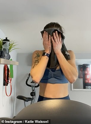 Tough workout: Towards the end, Katie wiped her sweaty face with a black towel