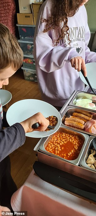 The children serve the cooked breakfast