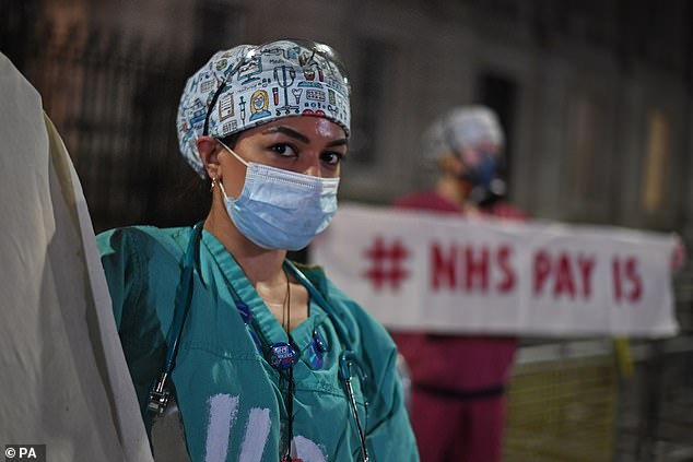 Wearing PPE and carrying a sign which read 'You failed the public, you failed the NHS, Boris must go', the five campaigners arrived at 8pm, the scheduled start time of the Clap For Heroes