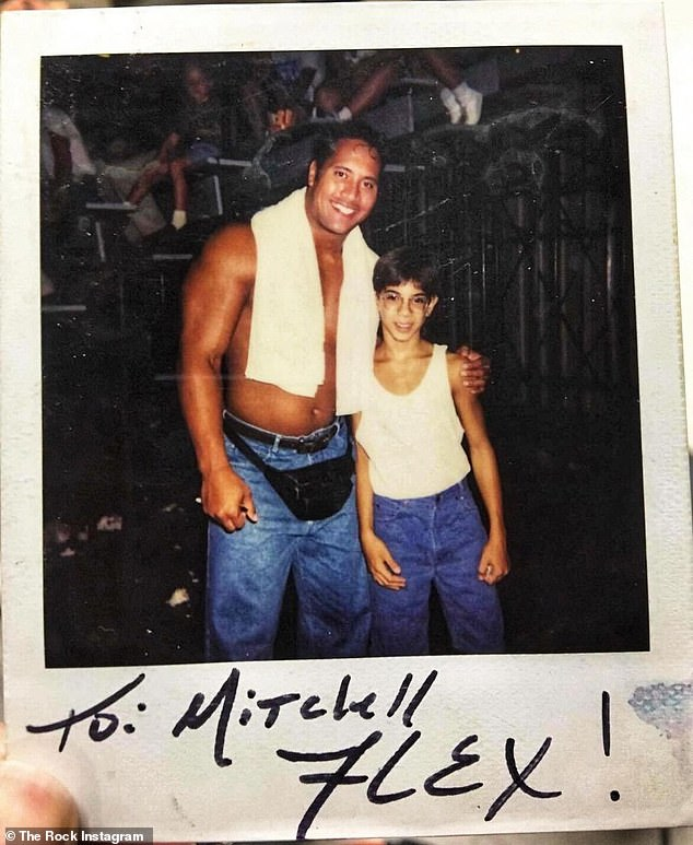 'TBT': Dwayne 'The Rock' Johnson took to Instagram on Thursday to share a throwback photo of himself with a young fan after one of his early pro-wrestling matches