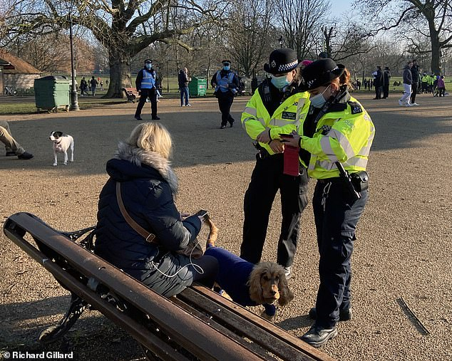 Scotland Yard Deputy Commissioner Sir Steve House yesterday revealed the extent of the crackdown as it emerged that officers are doling out 66 times more fines every day than during the first lockdown. Pictured: Police in Clapham Common, London
