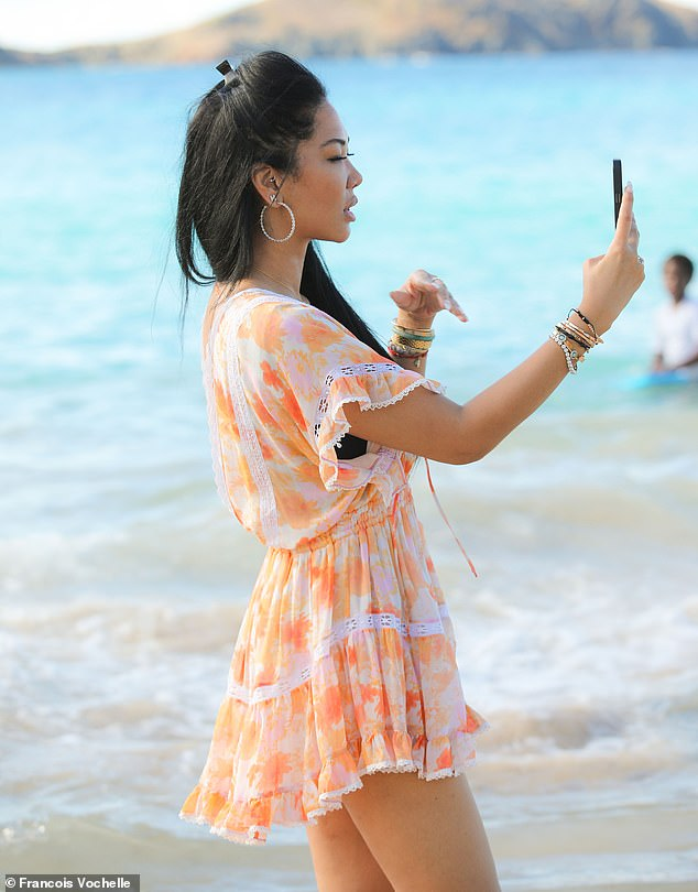 Snapshot:Lee Simmons appeared in awe of the island's natural beauty as she made sure to snap several shots of the clear blue waters on her phone