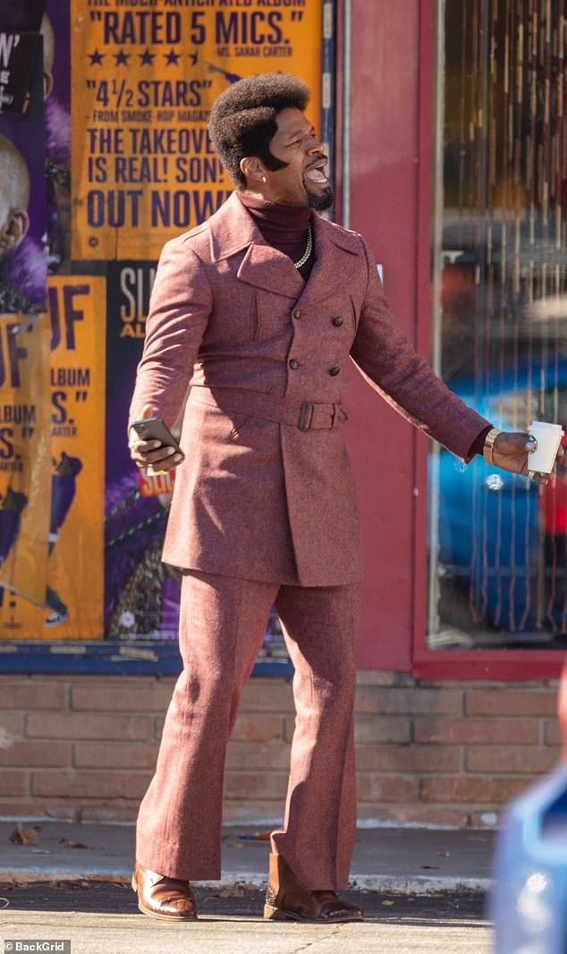 Getting in character: As the trio stepped on set, the 53-year-old Oscar winner wore a bold retro-inspired suit over a hot pink, snakeskin jacket with a fuchsia fur trim