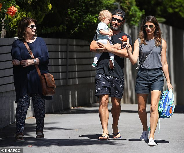 Out together: Joining the family was Zoë's mother, choreographer Ruth Osborne, who opted for a flowy navy top with patterned trousers