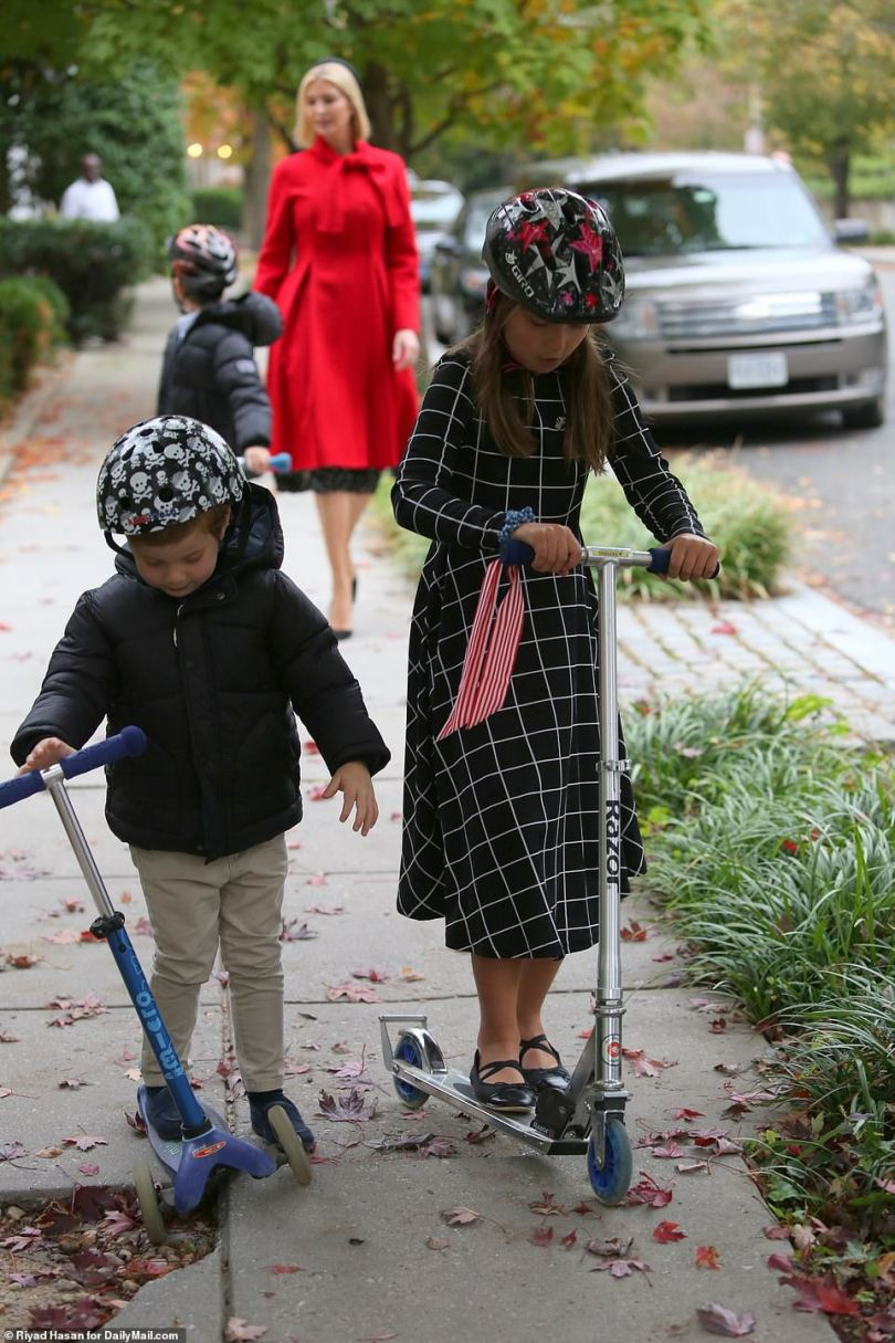 Ivanka takes children Arabella, 9, (right), Joseph, 7, (background) and Theodore, 4, (left) out for a scooter ride around Kalorama – the elite neighborhood used to seeing secret service as they guard Cabinet officials and former president's residences