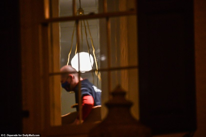Movers are seen working inside the Kalorama townhouse.The couple, who have been White House advisors throughout Donald Trump's term, are following him to Florida after he leaves office