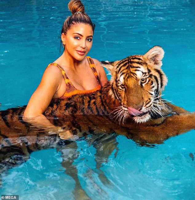 Majestic: She rocked a tiger-stripe orange bathing suit while holding an adult tiger in the pool