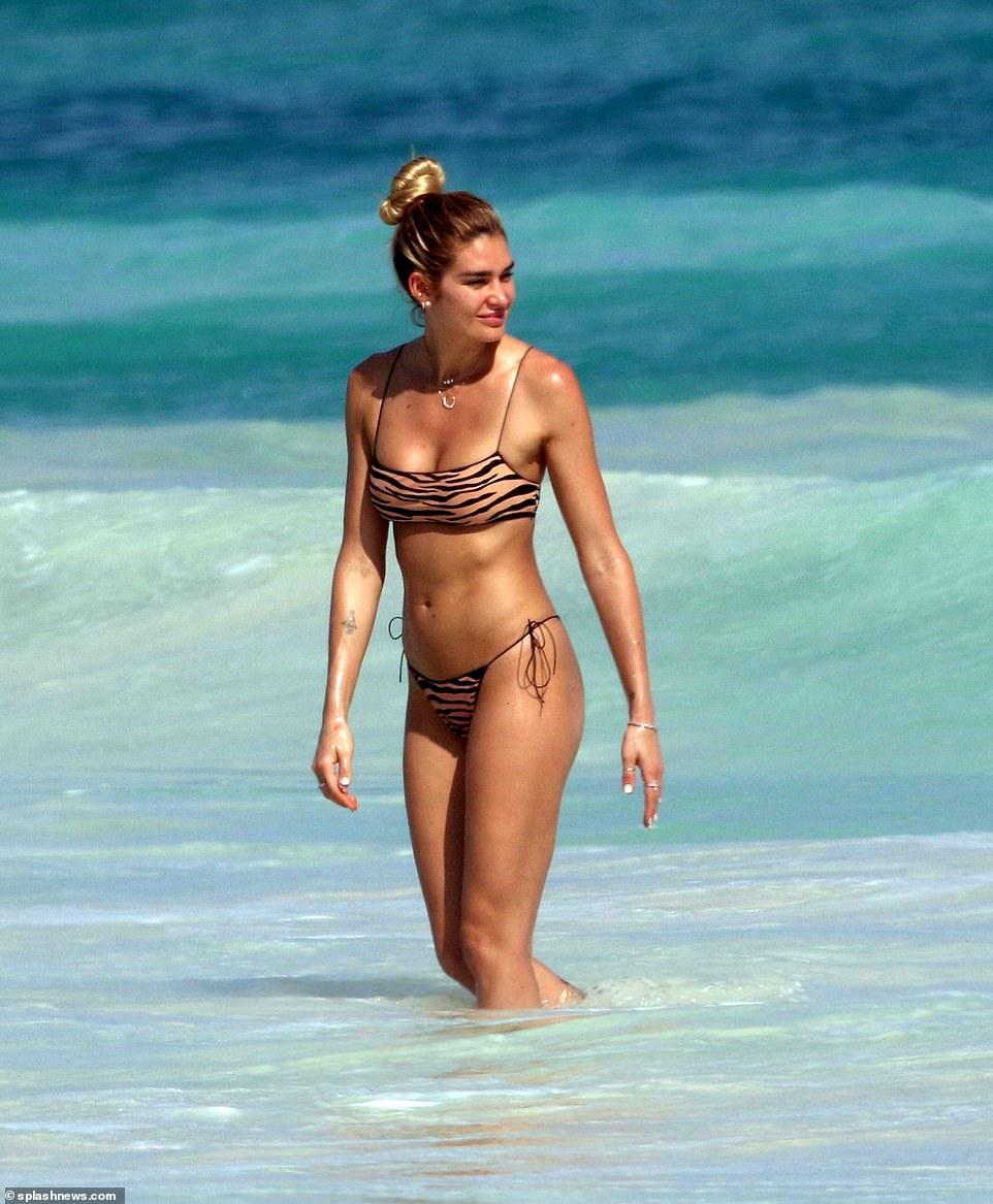 Ryan Seacrest's ex girlfriend Shayna Taylor sizzles in a bikini as she frolics on the beach