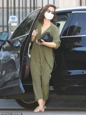 Minka Kelly looks chic in an olive jumpsuit while doing business in LA