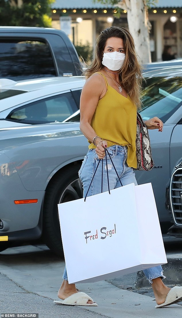 Shopping fun:Brooke chose cropped light wash denim with fluffy slippers, adding a v-neck yellow top
