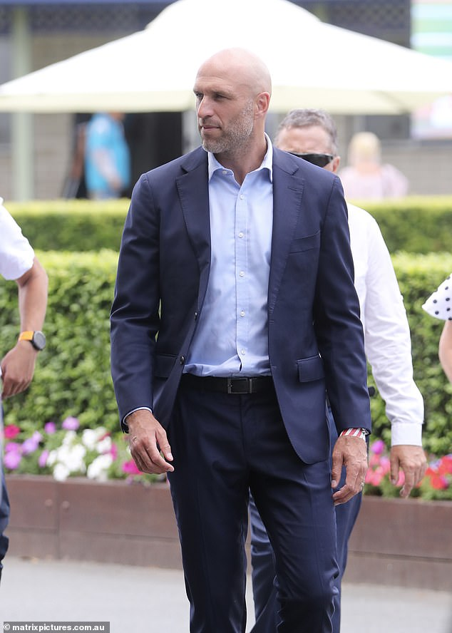 Looking dapper!  Chris Judd (pictured) looked dapper in a navy suit as he enjoyed a solo outing at Magic Millions Race Day on the Gold Coast on Saturday without his wife Bec Judd