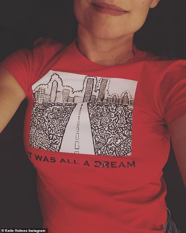 Supportive girlfriend: On Friday morning Katie posted a selfie in a red shirt that said 'it was all a dream,' as she tagged Emilio and revealed that he had painted the graphic on the shirt