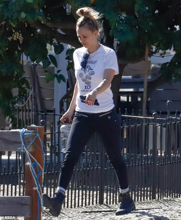The animal lover kept it casual on the outing with black pants and a white graphic T-shirt