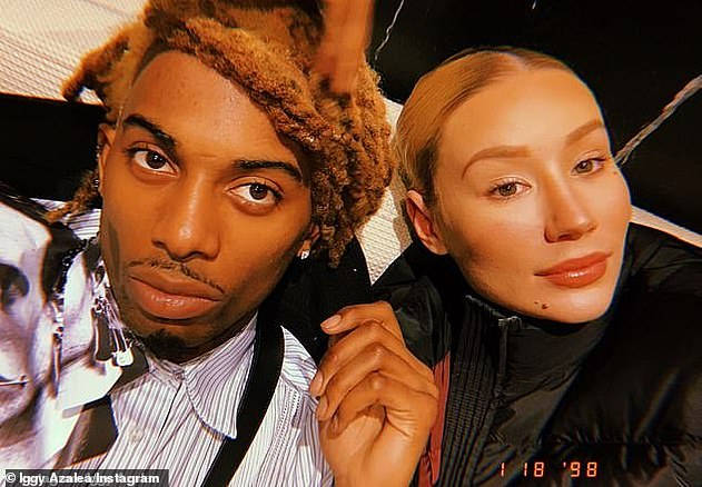 Peace: Iggy (right) recently revealed that she's made a truce with her baby daddy, Playboi Carti (left). In a post shared to Twitter last month, the rapper confirmed the pair had 'spoken'
