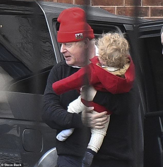 The Prime Minister was spotted on Sunday morning carrying his young son Wilf - showing off his already trademark blonde locks - to his buggy ahead of a walk, believed to be in Buckingham Palace Gardens