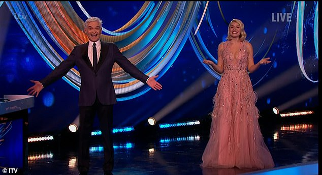 Beauty:The mother-of-three cut a glamorous figure in the figure hugging garment which featured a sequinned detail and a plunging neckline (pictured with Phillip Schofield)