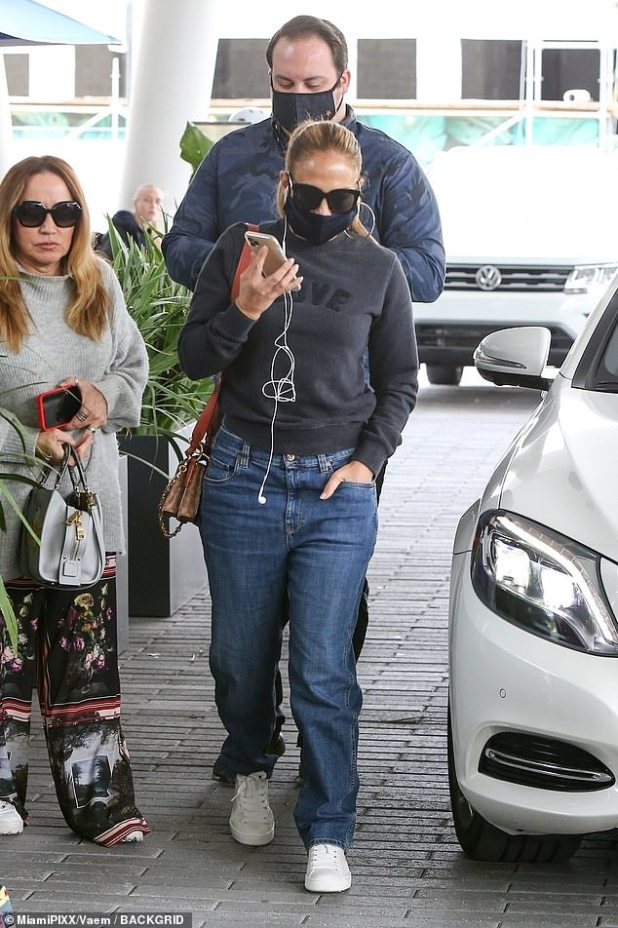 Glomie Day in Florida: Two-time Grammy nominee Jennifer Lopez wore baggy jeans to lunch with friends in Miami on Sunday.