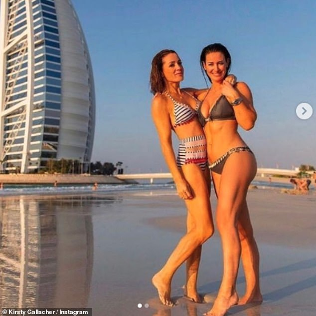 Wow:The fitness enthusiast looked sensational as she shared a series of sizzling throwback bikini snaps to her Instagram in January of her holiday in Dubai (pictured with Natalie Pinkham)