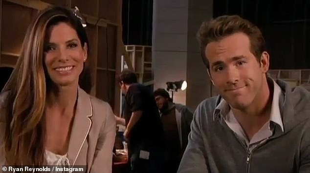 Leading lady: He appears with co-star Sandra Bullock, 56, at the beginning of the clip, as they film a behind-the-scenes segment, which is interrupted by White