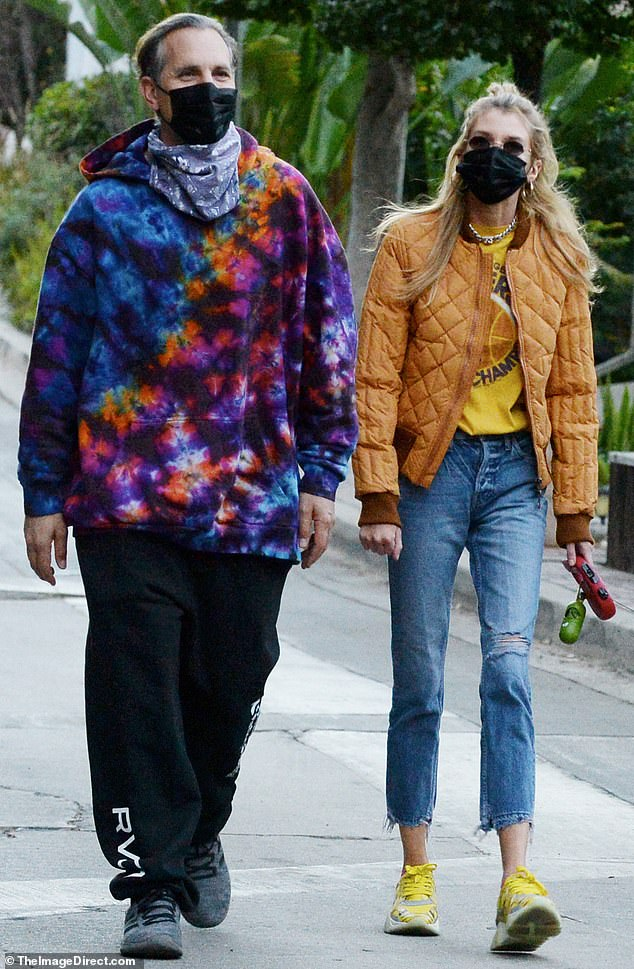 Stella Maxwell shows love for the Lakers as she steps out with a friend to walk her dog in LA