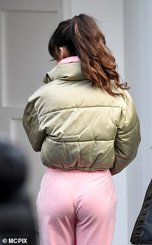 Stylish: The fashion designer swept her tresses into a high ponytail