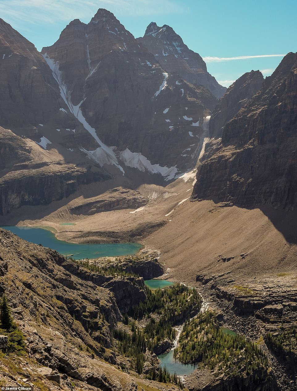 James says: 'Most of the places you see photographed from Canada are busy locations you can drive to. They are worth visiting, but if you do some research, you can get away from the chaos and experience a bit more of the Canadian wilderness.' Pictured is Lake Oesa, a lake 7,438ft (2,267m) up in the mountains of Yoho National Park