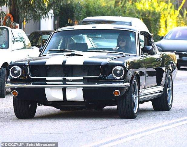 Wheels: The 31-year-old actress was spotted on the wheel of her vintage Shelby GT350 Mustang as she stayed at a friend's house